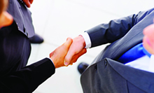 Image of two men shaking hands.